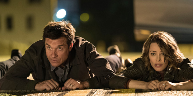 Rachel McAdams and Jason Bateman in a scene from Game Night.