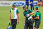 CD wicketkeeper Dane Cleaver retires hurt after he was promoted to open batting as unwanted Joshua Clarkson (left) and Ben Smith help him off Pukekura Park. Photo/Photosport