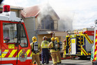 Whanganui's four fire trucks and two others attend the fire. PHOTO/ LEWIS GARDNER