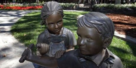 Bronze statues line the drive leading to the front of the main house at Neverland. Photo / AP