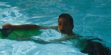 James Safechuck pictured swimming in one of Neverland's pools as shown in the Leaving Neverland documentary. Photo / Leaving Neverland