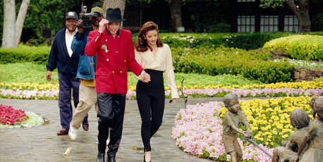 Lisa Marie Presley and then husband Michael Jackson go to greet children at his Neverland ranch in 1995. Photo / Getty Images