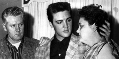 Elvis comforts his mother Gladys and his father Vernon on the eve of his induction into the US Army. Photo / AP