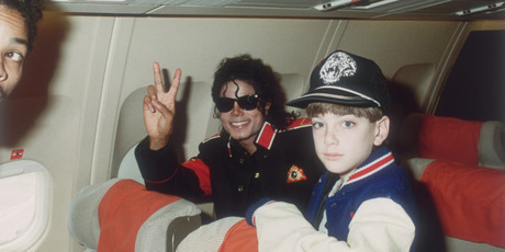 Michael Jackson with 10 year old Jimmy (James) Safechuck on the tour plane on 11th of July 1988.  Photo / Getty