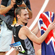Nicholas Willis carries the New Zealand national flag after he won the bronze medal in the Men's 1500 metre final race. Photo / Kenny Rodger