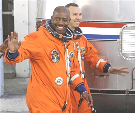 Astronauts Leland Melvin (left), and Randy Bresnik leave the Operations and Checkout building to ride out to launch pad 39A to board the shuttle. Photo / AP