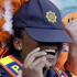 Netherlands' supporters joke with a police officer at the end of the World Cup group E soccer  match between the Netherlands and Japan  at Durban Stadium. Photo / AP