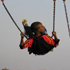 South African girls play on swings at a fan park as they watch the match between Australia and Ghana in the Diepsloot township, South Africa. Photo / AP