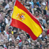 A Spanish flag is seen as hundreds of fans watch, at Barcelona's Plaza Espana, a live broadcast of the World Cup soccer final between Spain and the Netherlands. Photo / AP