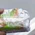 Workers place cereal bars inside a tube used as way of communication between the 33 trapper miners with the surface of the collapsed mine San Jose in Copiapo, Chile. Photo / AP