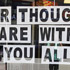 A sign which reads 'Our thoughts are with you all' is displayed in a Greymouth street in support of the 29 miners. Photo / Getty Images