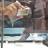 Joe Noh, left, takes photos of Nintendo 3DS at the Nintendo booth at the E3 Expo in Los Angeles. Photo / AP