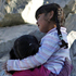 Martina, right, embraces Liset, both nieces of miner Mario Gomez, one of the 33 miners trapped at the San Jose mine, as they stand outside the mine in Copiapo, Chile. Photo / AP