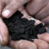 Vigtus Andresson holds dark wet ash in his hand on his Berjanes farm near the town of Hvolsvollur, Iceland. Photo / AP