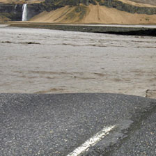 A broken section of Iceland's main coastal ring road near Reykjavik after melted water from a volcanic eruption caused river levels to rise by up to 3 meters. Photo / AP