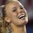 Caroline Wozniacki of Denmark celebrates winning match point in her third round match against Shahar Peer. Photo / Getty Images