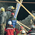 Miners, relatives and rescue workers stand outside a collapsed copper and gold mine during a rescue effort for 33 trapped miners in Copiapo, Chile. Photo / AP