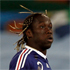 France's Bacary Sagna opts for a head of overgrown maggots in lieu of actual hair. Photo / AP.