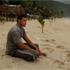 Tauasili Iulai, who lost his 7 year-old daughter Ana Iulai in the Tsunami, sits on Seleapaga beach, where he still lives. Photo / Brett Phibbs