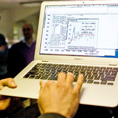 Scientists from CERN follow the high energy collision on a computer. Photo / AP.