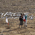 Relatives stand among Chilean flags with the names of the 33 miners trapped at the San Jose collapsed mine in Copiapo, Chile. Photo / AP