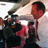 Opposition leader Tony Abbott uses a TV Camera as a weight while aboard the Official Liberal Party Media Bus in Brisbane, Australia. Photo / Getty Images.