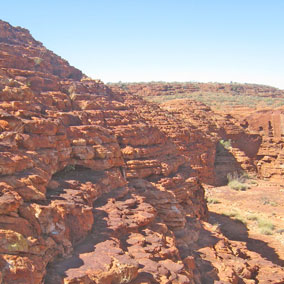 Kings Canyon is situated in the Watarrka National Park, some 450km south west of Alice, with incredible sheer cliffs and domed rocks that look like piles of pancakes. Photo / Greg Dixon