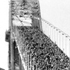 Members of the public walk over the Harbour Bridge a week before it was officially opened. Photo / NZ Herald