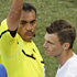 Referee Carlos Batres of Guatemala (C) shows a yellow card to New Zealand's Tommy Smith during the Group F match against Italy in Nelspruit. Photo / AP