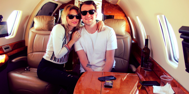 Gilbert Ott and Laura Burns scored a free flight by 'gaming' online promo codes. Photo / Supplied