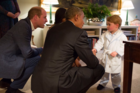 Prince George politely shook hands with the President as he and Mrs Obama fussed over him. Photo: @KensingtonRoyal / Twitter