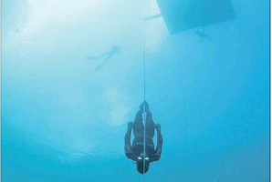 William Trubridge dives without propulsion, with only a rope to assist his descent into the deep blue and ascent to the light.