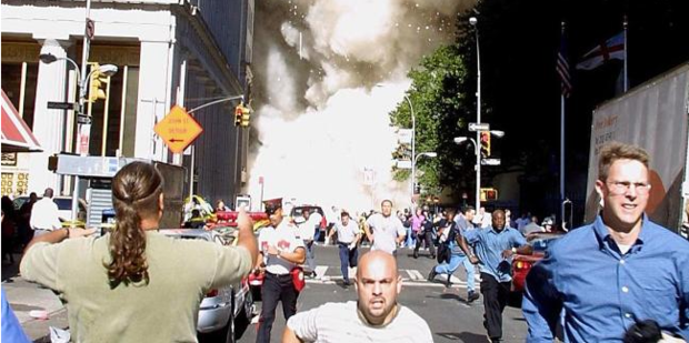 New Yorkers run for their lives after the attacks on the World Trade Center. Photo / AFP