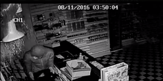 CCTV footage shows a man leaving with a till from Body FX, Morningside. PHOTO / SUPPLIED