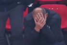 Toulouse manager Pascal Dupraz after being hit by a paper plane. Photo / YouTube