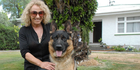 Sue Oomen with her German shepherd Bruza, who she nursed back to health after he contracted tetanus when he was three months old. Photo / Emily Norman