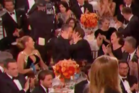 Ryan Reynolds and Andrew Garfield lock lips at the Golden Globes.