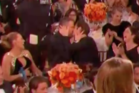 Ryan Reynolds and Andrew Garfield lock lips at the Globes.