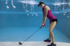 In the drink. Lexi Thompson looks to play a shot from underwater. Photo / Twitter