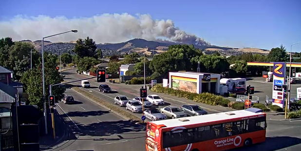 Smoke billows from two wildfires burning on the tinder-dry Port Hills near Christchurch. Photo / CTOC