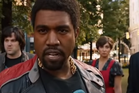 Kanye West in character as a MTV VJ during Anchorman 2's fight scene. Photo/YouTube