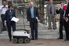 District of Columbia Council member Mary M. Cheh and former council member David Catania watch as an autonomous delivery robot enters the Wilson Building for a demonstration. Photo / Washington Post