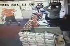 Security footage showing an attempted robbery at Mitchell Downs Liquor Centre around lunch time yesterday.