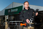Dave Crooks from Strainrite Fencing Systems with the Fieldays International Innovation Award-winning Activator Strap. Photo/Stephen Barker/Barker Photography