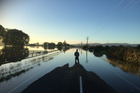 Flooded road on the outskirts of Edgecumbe in the Eastern Bay of Plenty. Photo / Alan Gibson