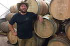 Winemaker Joel Watson say the oak barrels the wines are aged in are imported from France and cost $1-2k each. Photo/Melissa Nightingale