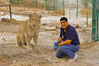 Khalil with Simba the lion at a Four Paws sanctuary in Jordan. Photo / The Telegraph, Four Paws