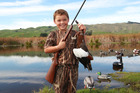 Blake Paling, 7, shot his first duck on the first day of duck shooting season at Pekapeka Regional Park this morning. Photo/Duncan Brown