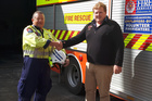 Eketahuna Fire Chief Max Mayer, pictured with AFFCO buyer Daniel Stephens, said the brigade was able to buy some new helmet torches with their donation last year.