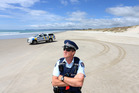 Senior Sergeant Martin Geddes and a team of volunteers with support from local businesses have been driving home the safety message to crab fishers on the Ruakaka coastline. Photo / File